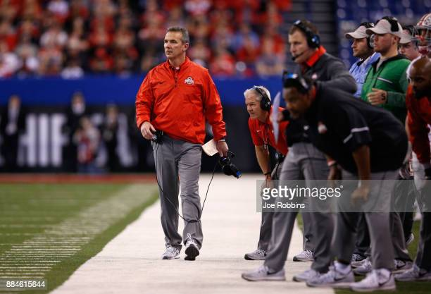 Head coach Urban Meyer of the Ohio State Buckeyes looks on as they play the Wisconsin Badgers during the second half of the the Big Ten Championship...