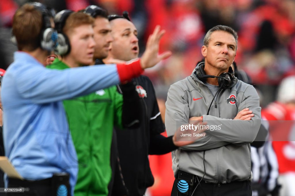 Head Coach Urban Meyer of the Ohio State Buckeyes looks up at the scoreboard as his coaches send in plays in the fourth quarter against the Michigan State Spartans at Ohio Stadium on November 11, 2017 in Columbus, Ohio. Ohio State defeated Michigan State 48-3.