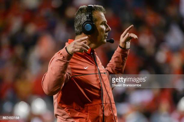 Head coach Urban Meyer of the Ohio State Buckeyes signals against the Nebraska Cornhuskers at Memorial Stadium on October 14 2017 in Lincoln Nebraska