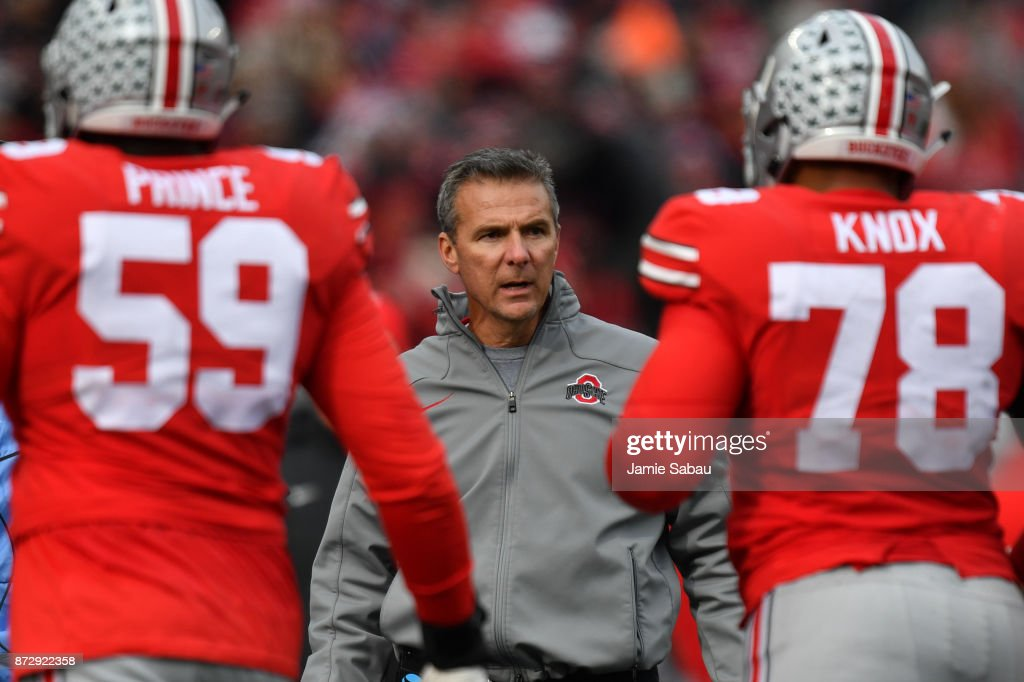 Head Coach Urban Meyer of the Ohio State Buckeyes talks with his players as they come off the field in the third quarter against the Michigan State Spartans at Ohio Stadium on November 11, 2017 in Columbus, Ohio. Ohio State defeated Michigan State 48-3.