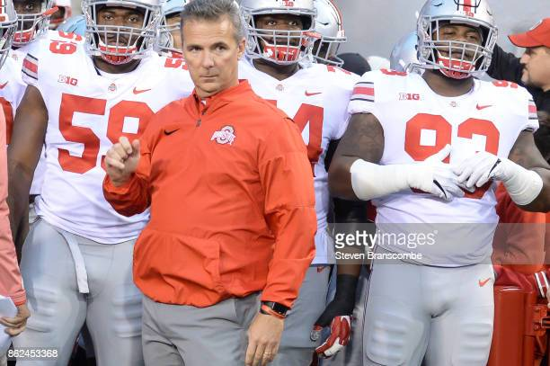 Head coach Urban Meyer of the Ohio State Buckeyes waits to lead the team on the field against the Nebraska Cornhuskers at Memorial Stadium on October...