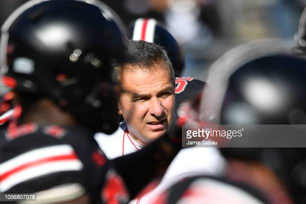 Head Coach Urban Meyer of the Ohio State Buckeyes watches his team warm up before a game against the Nebraska Cornhuskers at Ohio Stadium on November...