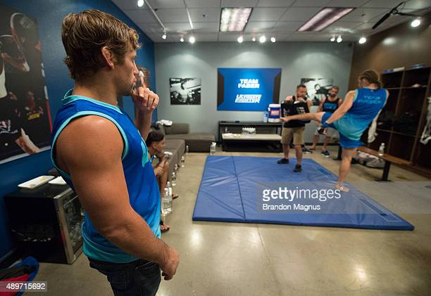 Head coach Urijah Faber watches as Chris Gruetzemacher warms up before facing Sascha Sharma during the filming of The Ultimate Fighter Team McGregor...
