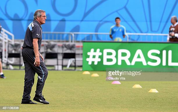 Head coach Uruguay Oscar Tabarez looks on during a training session at the Dunas Arena in Natal on June 23 2014 in Natal Brazil