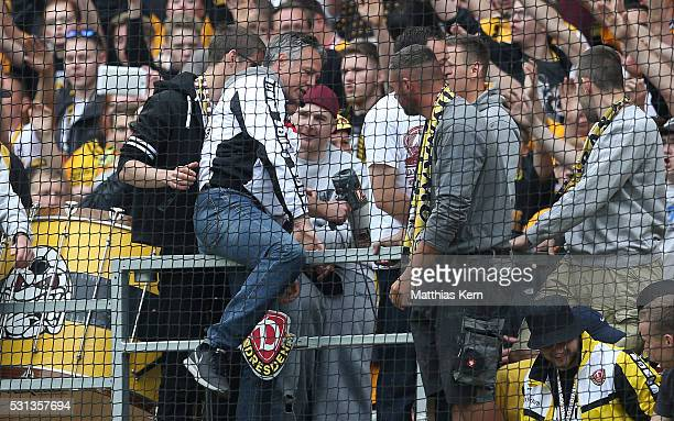 Head coach Uwe Neuhaus of Dresden celebrates with his supporters after winning the championship title of the third league after the third league...
