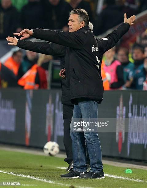 Head coach Uwe Neuhaus of Dresden gestures during the Second Bundesliga match between SG Dynamo Dresden and Eintracht Braunschweig at DDVStadion on...