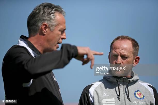 Head coach Uwe Neuhaus of Dynamo Dresden und Head coach Torsten Lieberknecht of Eintracht Braunschweig looks on during the Second Bundesliga match...