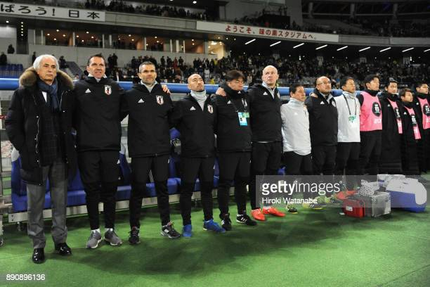 Head coach Vahid Halilhodzic and Japan staffs line up prior to the EAFF E1 Men's Football Championship between Japan and China at Ajinomoto Stadium...