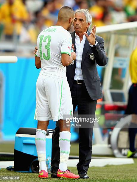 Head coach Vahid Halilhodzic of Algeria speaks to Islam Slimani during the 2014 FIFA World Cup Brazil Group H match between Belgium and Algeria at...