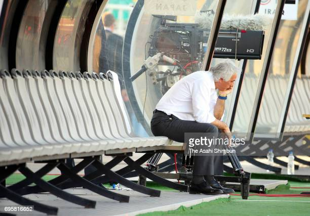 Head coach Vahid Halilhodzic of Japan remains on the bench after his side's 11 draw in the FIFA World Cup Russia Asian Final Qualifier match between...