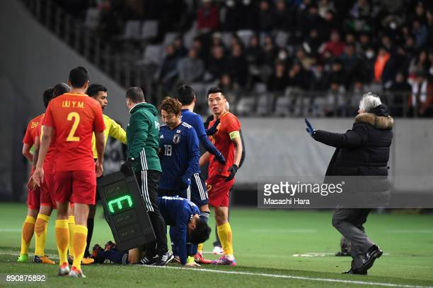 Head coach Vahid Halilhodzic of Japan tries to intervene as players argue during the EAFF E1 Men's Football Championship between Japan and China at...