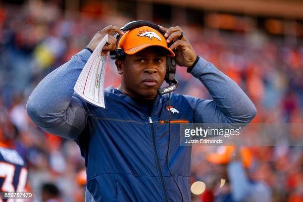 Head coach Vance Joseph of the Denver Broncos adjusts his headset before a game against the New York Jets at Sports Authority Field at Mile High on...