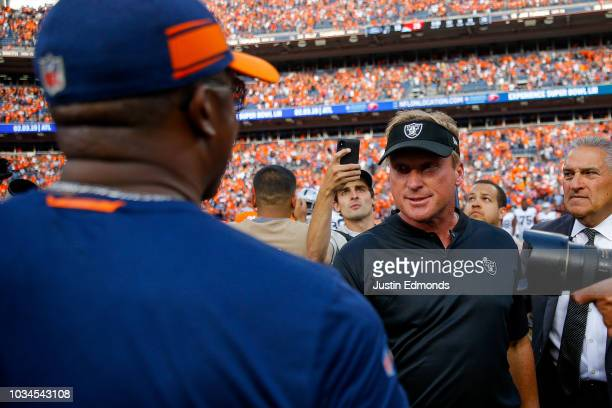 Head coach Vance Joseph of the Denver Broncos and head coach Jon Gruden of the Oakland Raiders shake hands after a 2019 Denver Broncos win at Broncos...
