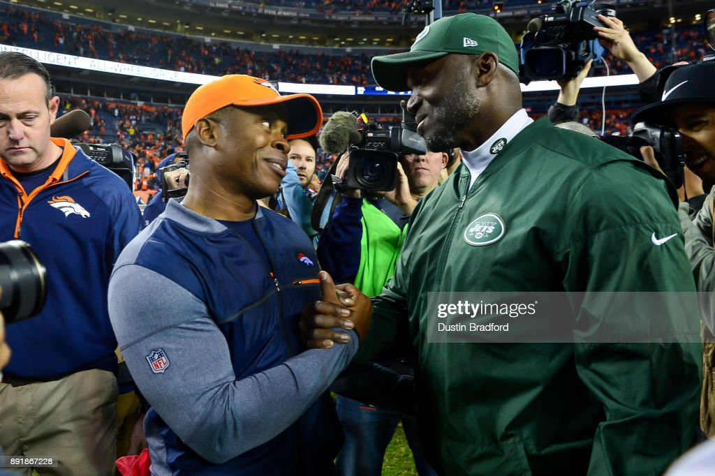 Head coach Vance Joseph of the Denver Broncos and head coach Todd Bowles of the New York Jets shake hands after the Denver Broncos 23-0 win over the New York Jets at Sports Authority Field at Mile High on December 10, 2017 in Denver, Colorado.