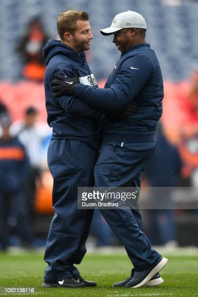 Head coach Vance Joseph of the Denver Broncos greets head coach Sean McVay of the Los Angeles Rams on the field as players warm up before a game...