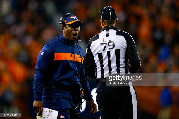 Head coach Vance Joseph of the Denver Broncos has a word with head linesman Kent Payne in the second quarter of a game against the Cleveland Browns...