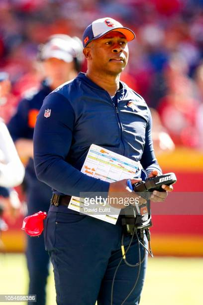 Head coach Vance Joseph of the Denver Broncos looks at a player coming off the field during the first half of the game against the Kansas City...