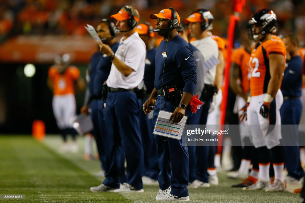 Head coach Vance Joseph of the Denver Broncos looks on from the sideline during a Preseason game against the Green Bay Packers at Sports Authority Field at Mile High on August 26, 2017 in Denver, Colorado.