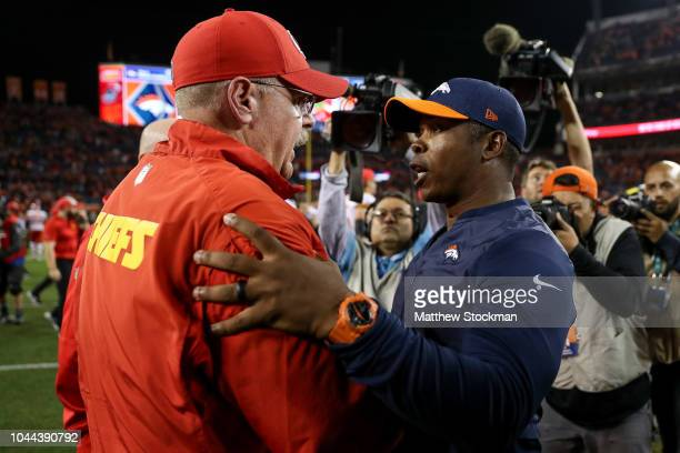 Head coach Vance Joseph of the Denver Broncos shakes hands with head coach Andy Reid of the Kansas City Chiefs after a 2723 Chiefs win over the...