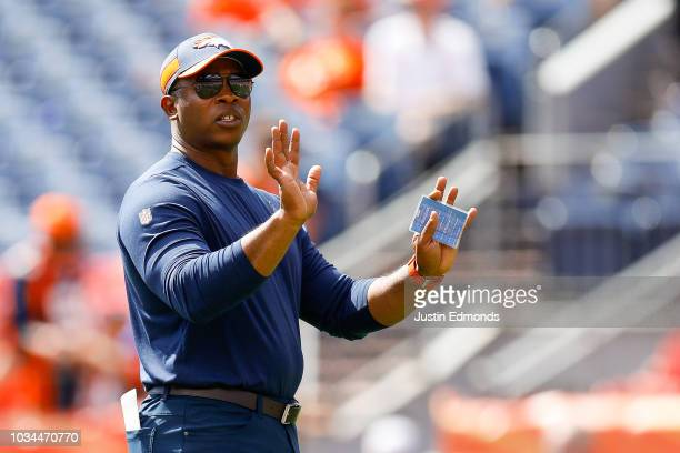 Head coach Vance Joseph of the Denver Broncos stands on the field before a game against the Oakland Raiders at Broncos Stadium at Mile High on...