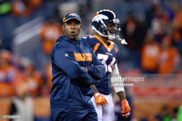 Head coach Vance Joseph of the Denver Broncos stands on the field before a game against the Cleveland Browns at Broncos Stadium at Mile High on...