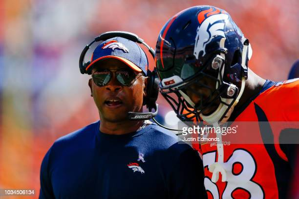 Head coach Vance Joseph of the Denver Broncos talks to linebacker Von Miller during a game against the Oakland Raiders at Broncos Stadium at Mile...