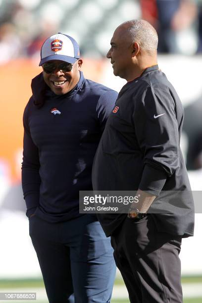 Head coach Vance Joseph of the Denver Broncos talks with head coach Marvin Lewis of the Cincinnati Bengals prior to the start of the game at Paul...