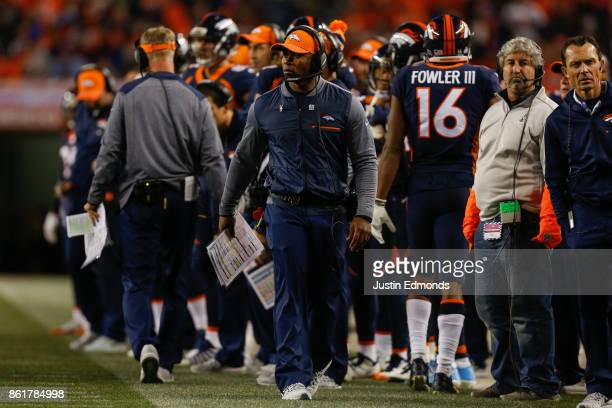 Head coach Vance Joseph of the Denver Broncos walks on the field during the fourth quarter against the New York Giants at Sports Authority Field at...