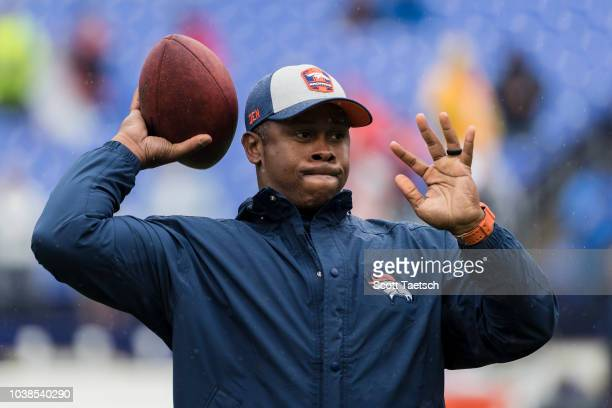 Head coach Vance Joseph of the Denver Broncos warms up before the game against the against the Baltimore Ravens at MT Bank Stadium on September 23...