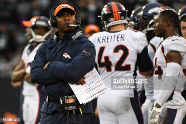 Head coach Vance Joseph of the Denver Broncos watches a replay during their NFL game against the Oakland Raiders at OaklandAlameda County Coliseum on...