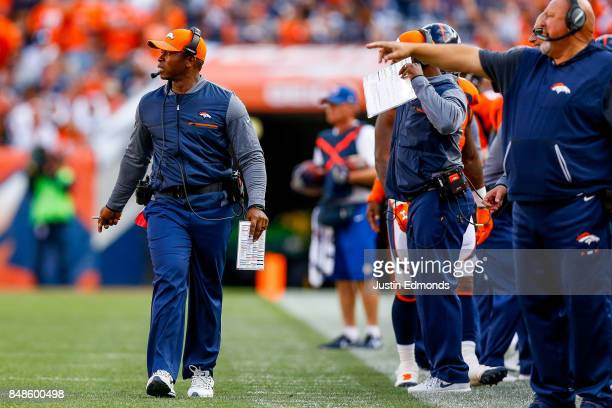 Head coach Vance Joseph walks along the sideline during the second quarter of a game against the Dallas Cowboys of the Denver Broncos at Sports...