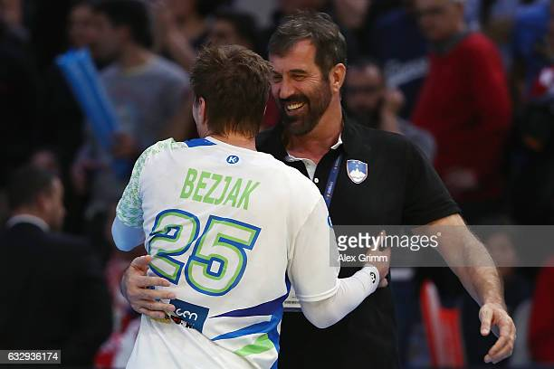 Head coach Veselin Vujovic of Slovenia hugs Marko Bezjak after the 25th IHF Men's World Championship 2017 Bronze Medal Game between Slovenia and...
