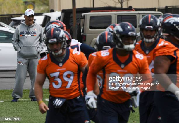 Head Coach Vic Fangio keeps an eye on practice during the Denver Broncos Rookie Mini Camp at UChealth Training Center on May 10 2019 in Centennial...
