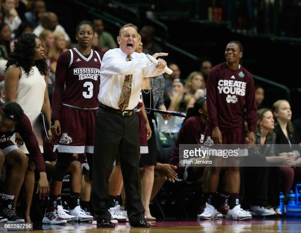 Head coach Vic Schaefer of the Mississippi State Lady Bulldogs reacts in the third quarter against the Connecticut Huskies during the semifinal round...