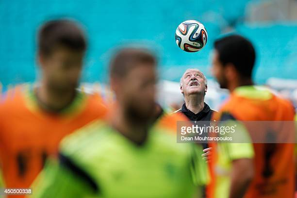 Head Coach Vicente del Bosque juggles the ball on his head as the players warm up during the Spain training session ahead of the 2014 FIFA World Cup...