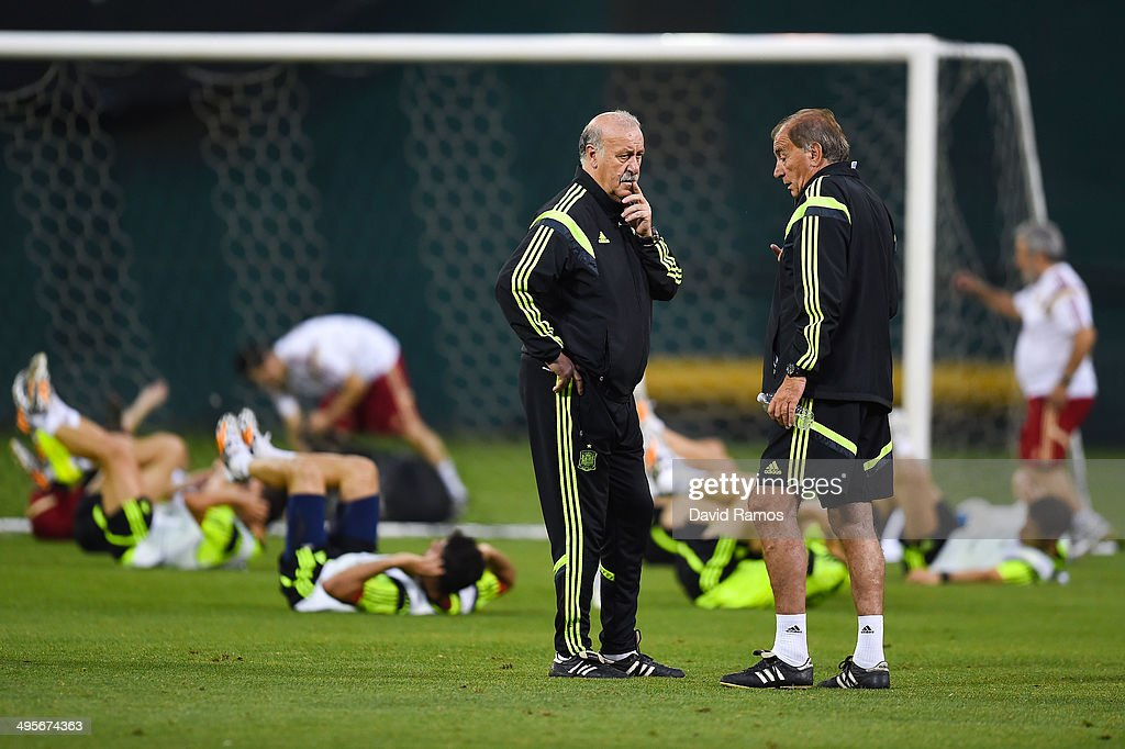 Head coach Vicente Del Bosque of Spain chats with his first assistant Paco Grande during a training session of the Spain National Team at the Robert F. Kennedy Stadium on June 4, 2014 in Washington, DC.