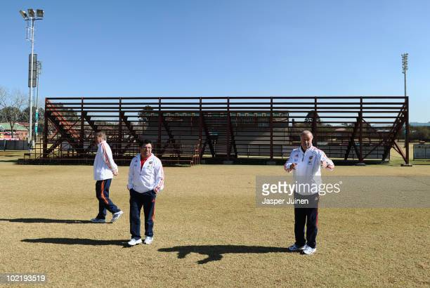 Head coach Vicente del Bosque of Spain gestures while walking the surroundings of the team hotel with members of his staff Antonio Fernandez and Toni...