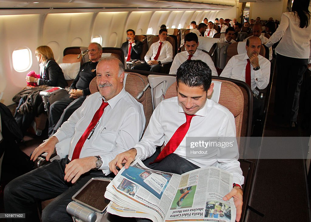 Head coach Vicente del Bosque (L) of Spain smiles as he sits flanked by Fernando Hierro shortly after touch down at Johannesburg airport on June 11, 2010 in Johannesburg, South Africa.