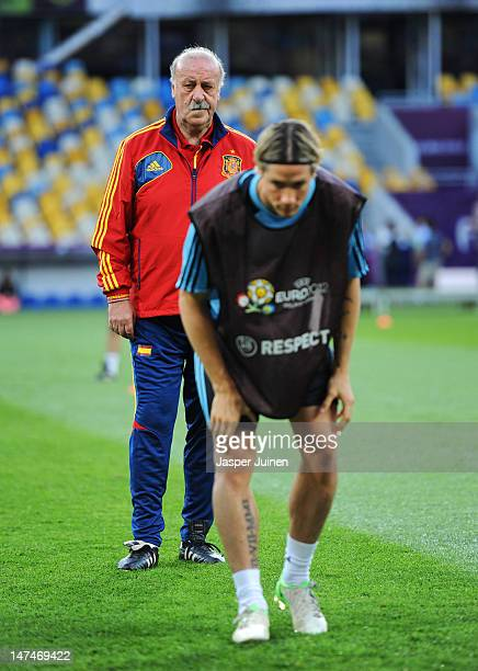 Head coach Vicente del Bosque of Spain stands behind Fernando Torres doing his warm up during a training session ahead of the UEFA EURO 2012 final...