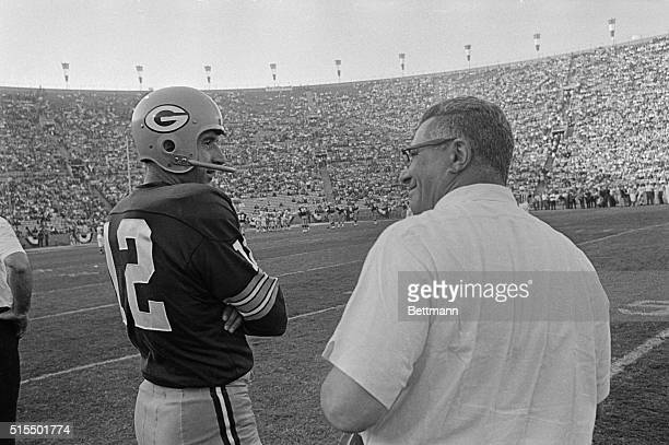 Head Coach Vince Lombardi Green Bay Packers talking to reserve quarterback Zeke Bratowski on sidelines during Super Bowl game against the Kansas City...