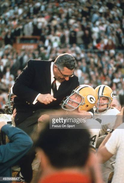 Head Coach Vince Lombardi of the Green Bay Packers gets carried off the field by his players after they defeated the Oakland Raiders in Super Bowl II...