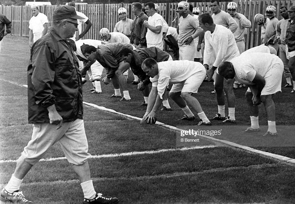 Head coach Vince Lombardi of the Green Bay Packers looks on as his recruits and veterans began their first day of drills for the 1967 season on July 13, 1967 in Green Bay, Wisconsin.