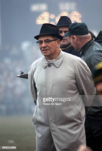 Head coach Vince Lombardi of the Green Bay Packers looks on from the sidelines during an NFL game circa 1965 at Lambeau Field in Green Bay Wisconsin...