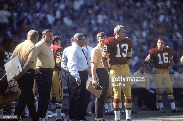 Head coach Vince Lombardi of the Washington Redskins watches from the sideline next to quarterback Frank Ryan against the St Louis Cardinals at RFK...