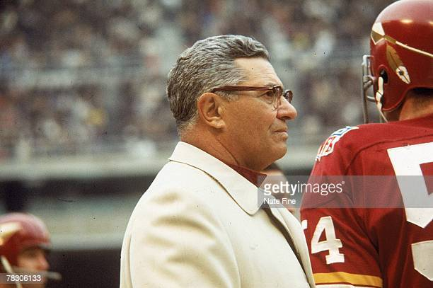 Head coach Vince Lombardi of the Washington Redskins watches from the sideline against the New Orleans Saints at RFK Stadium on December 141969 in...