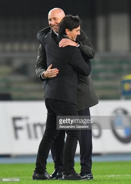 head coach Vincenzo Montella of AC Milan embraces head coach Rolando Maran of AC Chievo Verona after the Serie A match between AC Chievo Verona and...