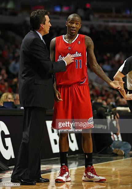 Head coach Vinny Del Negro of the Los Angeles Clippers talks with Jamal Crawford during a game against the Chicago Bulls at the United Center on...