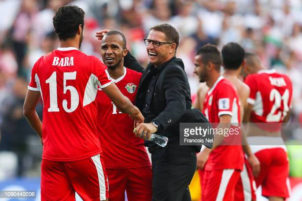 Head Coach Vital Borkelmans of Jordan celebrate with their players victory over Australia at the end of the AFC Asian Cup Group B match between...
