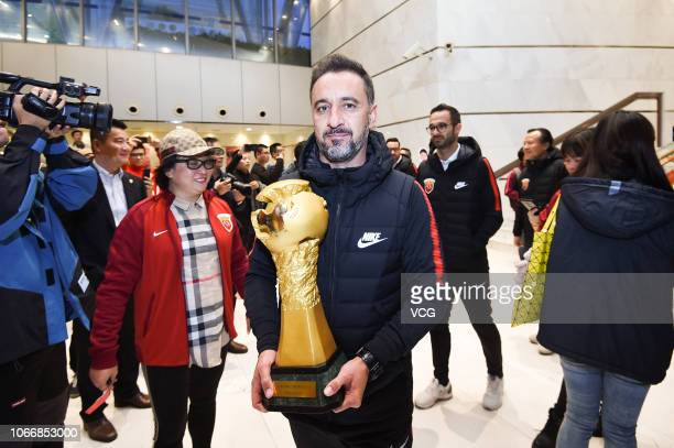 Head coach Vitor Pereira of Shanghai SIPG poses with his trophy in the celebration party as Shanghai SIPG was crowned Chinese Super League champion...