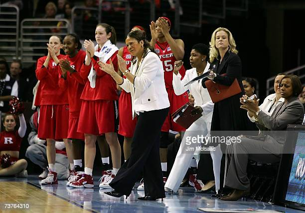 Head coach Vivian Stringer of the Rutgers Scarlet Knights applauds her teams play against the LSU Lady Tigers during the National Semifinal game of...